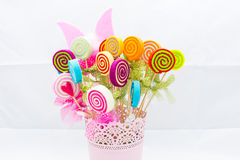 Vase of fake flowers with different colors. Delight in a basket. Stock Images