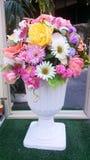 Vase of fake flowers Stock Photos