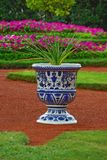 Vase with flower as an element of landscape design. Porcelain vase with the flower as an element of landscape design Stock Images