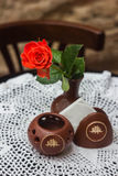 Vase with a flower on a cafe table Royalty Free Stock Image