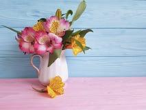 Vase flower fresh spring leaf alstroemeria elegance mother`s day, seasonal on a wooden arrangement. Vase fresh flower alstroemeria on a wooden bouquet stock image