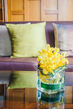 Vase flower on table with pillow on sofa Royalty Free Stock Photos