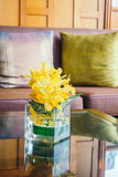 Vase flower on table with pillow on sofa Royalty Free Stock Images