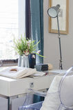 Vase of flower on white desk with lamp Royalty Free Stock Photo