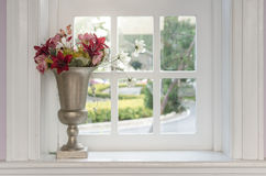 Vase of flower with window frame Royalty Free Stock Image