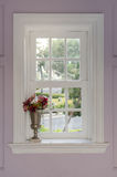 Vase of flower with window frame. At home Stock Photo