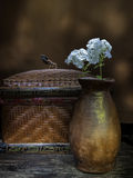 Vase of flowers and a basket. Stock Images