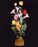 Vase of flowers on black C. Flowers in an earthen vase on black background Royalty Free Stock Image