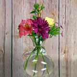 A vase of flowers. A vase of bouquet of flowers stock photography