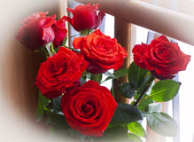 Vase with Flowers. Bouquet of roses on the windowsill. Vase with Flowers Stock Photo