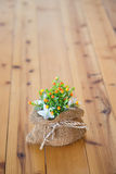 Vase of flowers in a brown bag. Royalty Free Stock Photo
