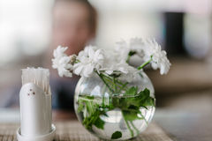 Vase with flowers in a cafe stock photo