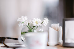 Vase with flowers in a cafe royalty free stock image