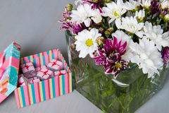 Vase with flowers and candy Royalty Free Stock Photo