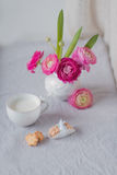 A vase of flowers and a cup with milk and cookies Royalty Free Stock Photos