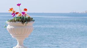Vase with Flowers. Vase of Flowers in the Italian style on a background of the sea Stock Photo