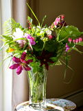 Vase of flowers on a june day Royalty Free Stock Images