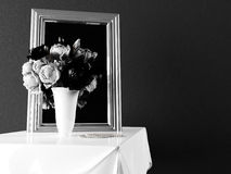 Vase with the flowers near the mirror Royalty Free Stock Photos