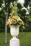 Vase with flowers in the park Royalty Free Stock Photo