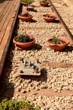 A vase of flowers on the railway. Decorative feature on the rails in Jerusalem Stock Photos