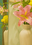 Vase of flowers reflected in mirror. A bouquet of flowers in a vase with reflection in a mirror Royalty Free Stock Image