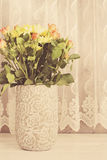 Vase of flowers. Rustic vase with orange roses and yellow chrysanthemums. White background, empty place, copy space. Vintage tinte Stock Photos