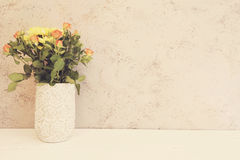Vase of flowers. Rustic vase with orange roses and yellow chrysanthemums. White background, empty place, copy space. Vintage tinte. Vase of flowers. Rustic vase Royalty Free Stock Image