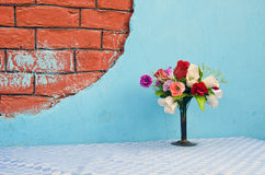 Vase with flowers on table Stock Images