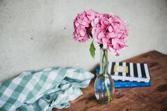 Vase of flowers on table Stock Photography