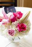 Vase with fresh flowers decorated for wedding celebration. Big round table vase with fresh cut garden flowers in the middle of this image. the flowers are: pink Stock Image