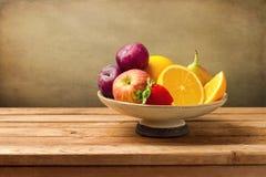 Vase with fresh fruits stock images