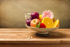 Vase with fresh fruits and flowers Royalty Free Stock Photo