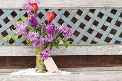Vase of Fresh Tulips and Lilac with Tag Royalty Free Stock Photos