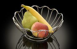 Vase with fruit. Vase with a banana, an apple and a pear Royalty Free Stock Images