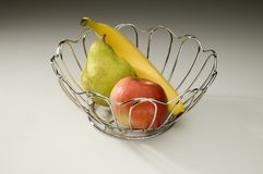 Vase with fruit. Vase with a banana, an apple and a pear Stock Photos