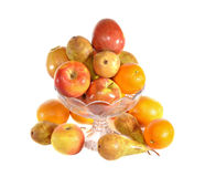 The vase with fruit. Costs on a table Stock Image