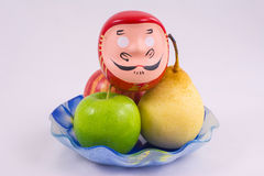 Vase with fruit. Japanese figurine head Samurai in a vase with fruit Royalty Free Stock Images