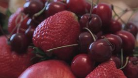 In a vase are the fruits for the holiday table. Close-up. Fruits in a vase. Cherries, strawberries, apples are in the vase. Hitting the camera stock video footage
