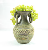 Vase full of grapes Royalty Free Stock Photos