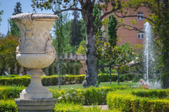 Vase in the garden of aranjuez palace. Decorative vase and fountain in the royal garden of the aranjuez palace. Aranjuez, Madrid, Spain Royalty Free Stock Photography