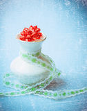 Vase with gift ribbon on blue textured background, romance vintage Stock Image