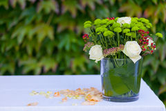 Vase of flowers. Vase of glass with flowers on the table Royalty Free Stock Images
