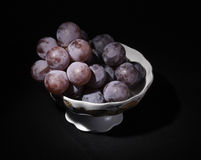 Vase with grapes Stock Photography
