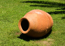 Vase on the grass. Clay vase on the grass Royalty Free Stock Photo