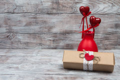 Vase with hearts on stick and gift for Valentines Day Royalty Free Stock Photos