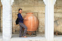 Vase in Istanbul Archaeology Museums in Istanbul. Smiling Papuan girl - young tourist woman standing by huge brown ceramic vase in Istanbul Archaeology Museums Stock Photography