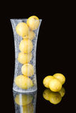 Vase with lemons Stock Photos