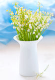 Vase with lily of the valley Stock Photos