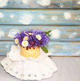 Vase with a nice bouquet of flowers on lacy napkin background Stock Images