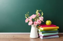Free Vase Of Flowers, Books And Apple On Wooden Table Near Green Chalkboard, Space For Text Royalty Free Stock Photography - 157911697